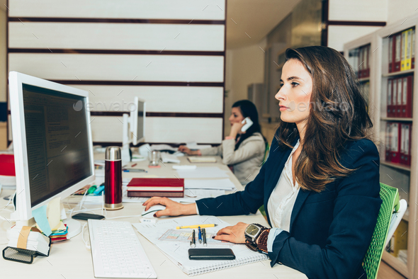 Female architects working in office - Stock Photo - Images