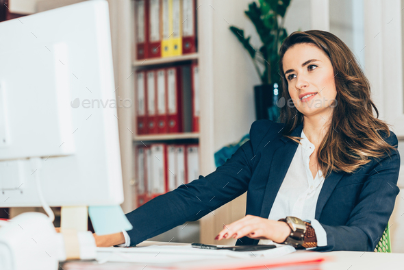 Female architect working in office - Stock Photo - Images