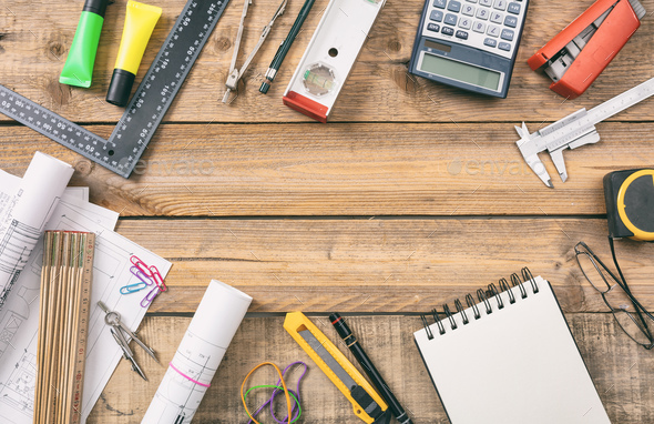 Project construction blueprints and engineering tools on wooden desk, copy space - Stock Photo - Images