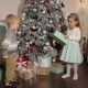 Two Small Children Open Gifts Near Christmas Tree. - VideoHive Item for Sale