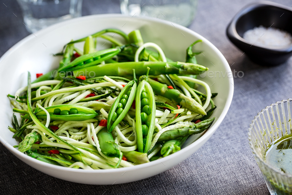 Zucchini Zoodles with Green Peas Salad  - Stock Photo - Images