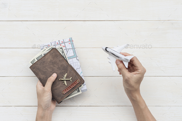 Traveler hand holding passport and map, Travel concept - Stock Photo - Images