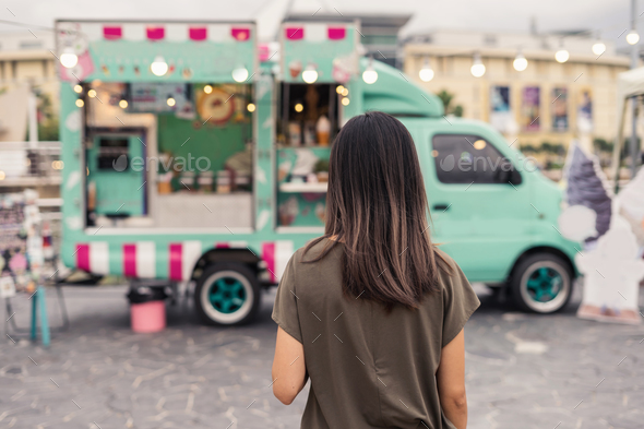 Young asian woman walking in the food truck market - Stock Photo - Images