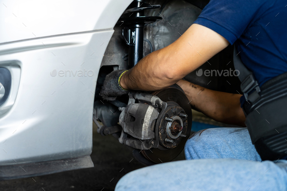 Technicians changing new shock absorbers - Stock Photo - Images