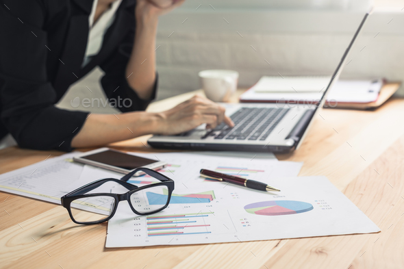 Businesswoman working on Desk office with marketing graph statistics analysis - Stock Photo - Images