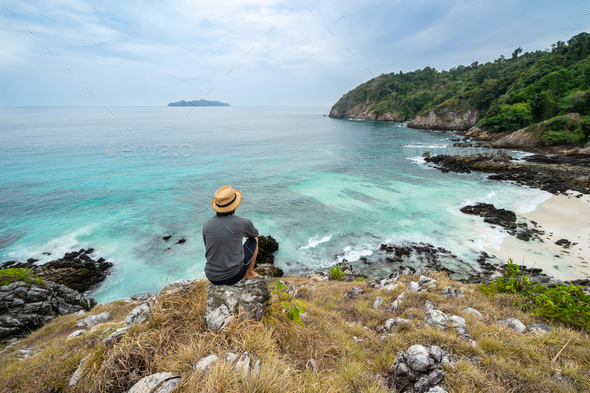 Young traveler looking beautiful seascape view - Stock Photo - Images