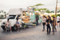 Abstract blurred image of people walking at the food truck market - PhotoDune Item for Sale