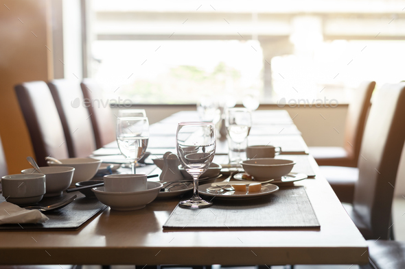Empty dirty glasses and plates on dinning table in restaurant - Stock Photo - Images