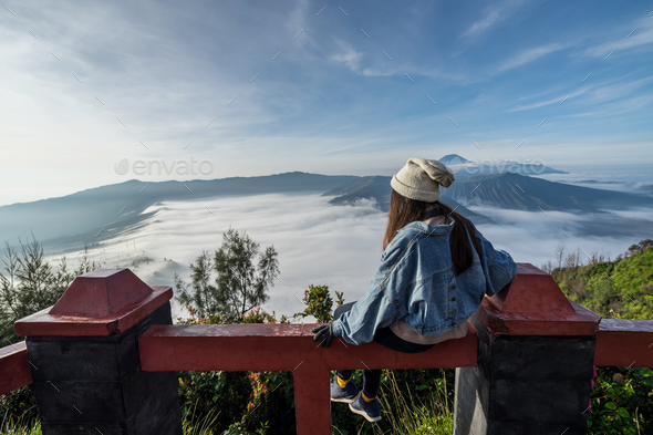 Young traveler looking at beautiful view of Mount Bromo volcano - Stock Photo - Images
