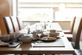 Empty dirty glasses and plates on dinning table in restaurant - PhotoDune Item for Sale