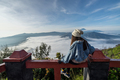Young traveler looking at beautiful view of Mount Bromo volcano - PhotoDune Item for Sale