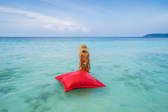 Young woman relaxing and enjoying with float mattress at the tropical beach - Stock Photo - Images