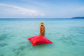 Young woman relaxing and enjoying with float mattress at the tropical beach - PhotoDune Item for Sale