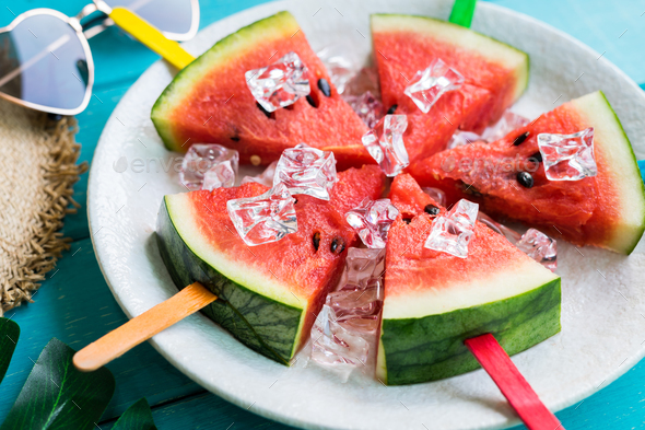 Watermelon slice popsicles with colorful stick on wooden background, Summer fruits - Stock Photo - Images