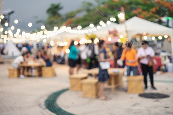 Abstract blurred image of people walking at the night market - Stock Photo - Images