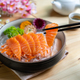 Salmon sashimi slice fresh serve on ice with tea, Japanese style - PhotoDune Item for Sale