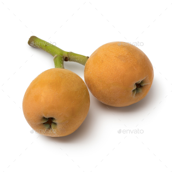 Pair of fresh picked loquats - Stock Photo - Images