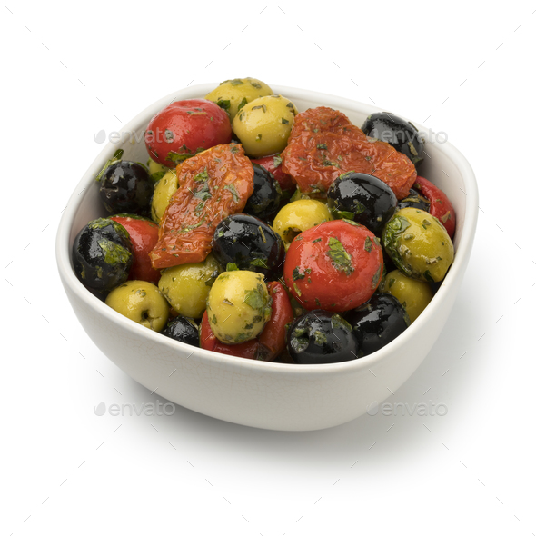 Bowl with green and black olives, peppers and tomatoes - Stock Photo - Images