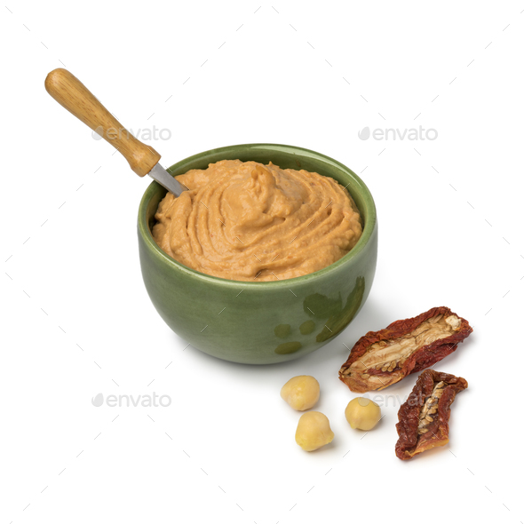 Bowl with Lebanese hummus made from chickpeas and sundried toma - Stock Photo - Images