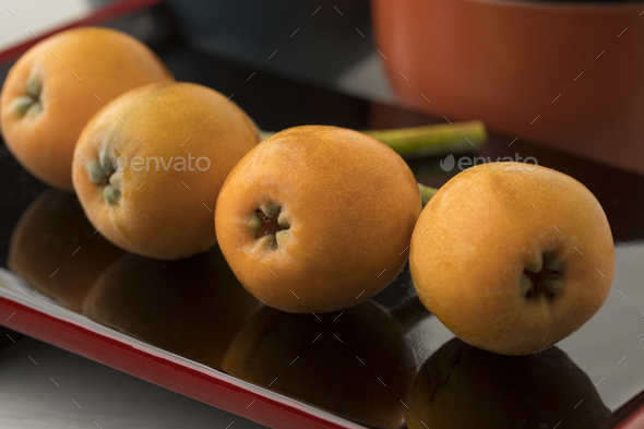 Fresh picked loquats on a Japanese dish - Stock Photo - Images
