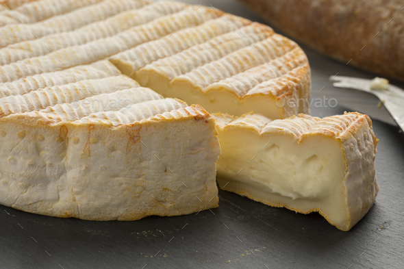 French Le Marcaire cheese on a cheeseboard - Stock Photo - Images