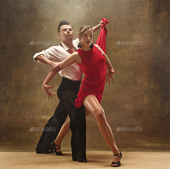 Flexible young modern dance couple posing in studio. - Stock Photo - Images