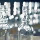 Ribbed Necks of Glass Bottlings Moving Along the Transporter in a - VideoHive Item for Sale