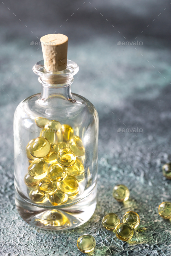 Baked asparagusOmega-3 fish oil capsules - Stock Photo - Images