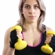 Woman Practicing Kickbox with Yellow Dumbbells - VideoHive Item for Sale
