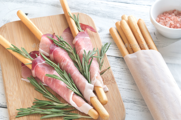 Breadsticks wrapped in ham - Stock Photo - Images