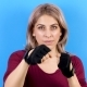 Woman Practicing Kickboxing in Sport Gloves - VideoHive Item for Sale