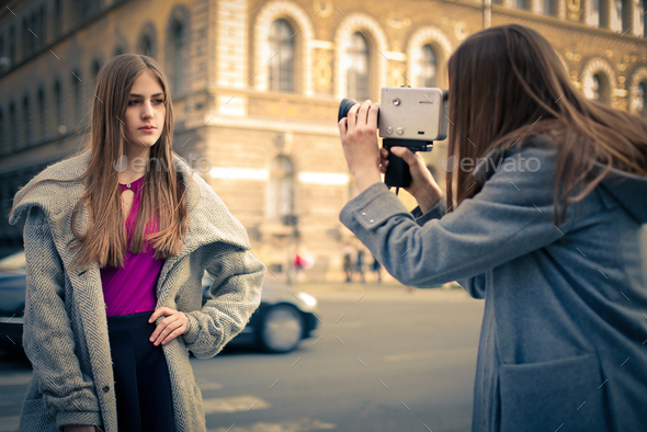 Girl filming another girl - Stock Photo - Images