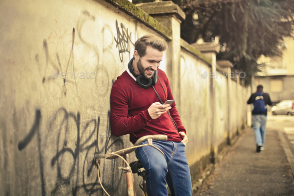 Man looking at his smartphone - Stock Photo - Images
