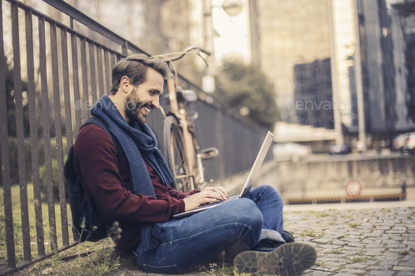 Man with a laptop outdoor - Stock Photo - Images