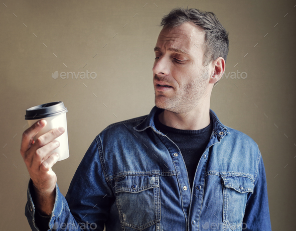 Man with a cup of coffee - Stock Photo - Images