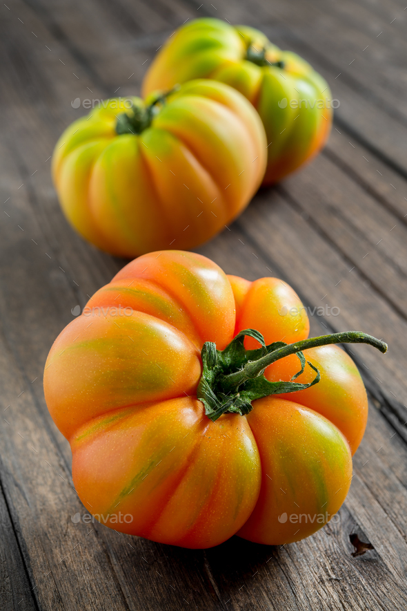 tomato marmande on wooden table - Stock Photo - Images