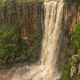Flooded Umgeni River plunges 95 m down the Howick Falls - PhotoDune Item for Sale