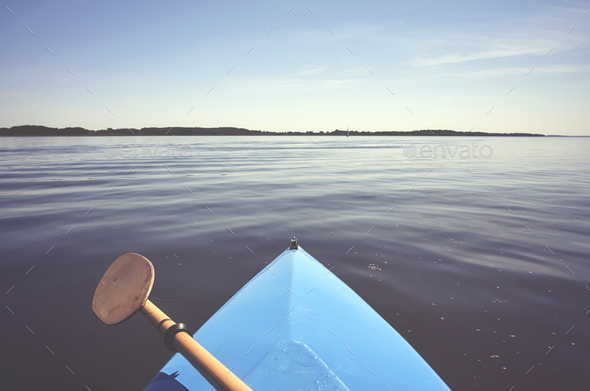Bow of a kayak and a paddle. - Stock Photo - Images