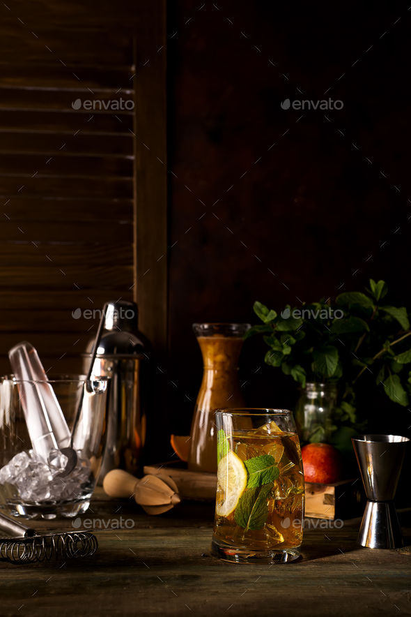 whiskey based cocktail on dark wooden backgorund - Stock Photo - Images