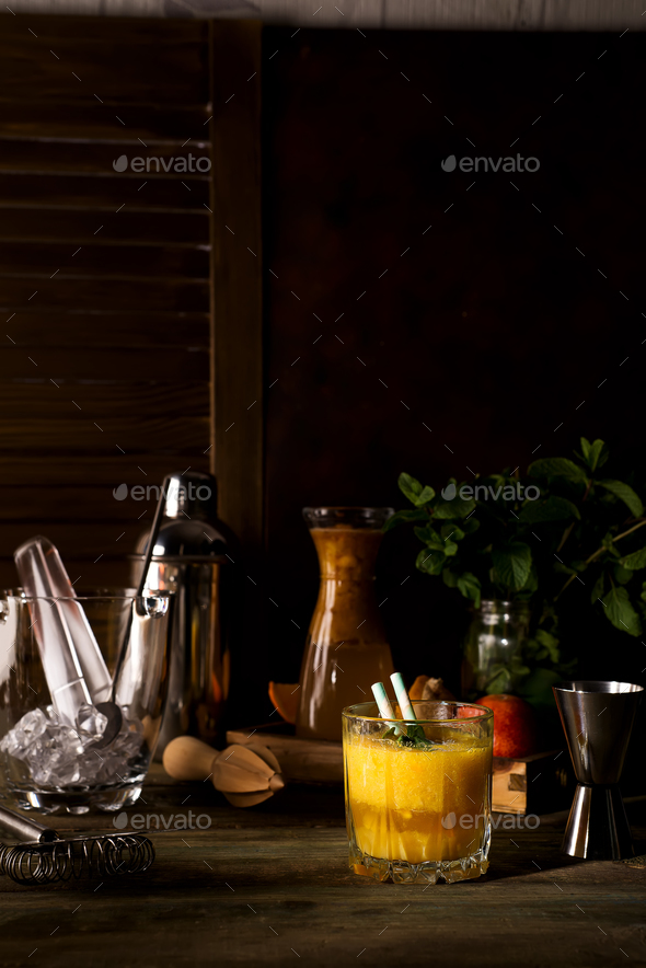 Smoothie cocktail of orange in a glass on dark wooden backgorund - Stock Photo - Images