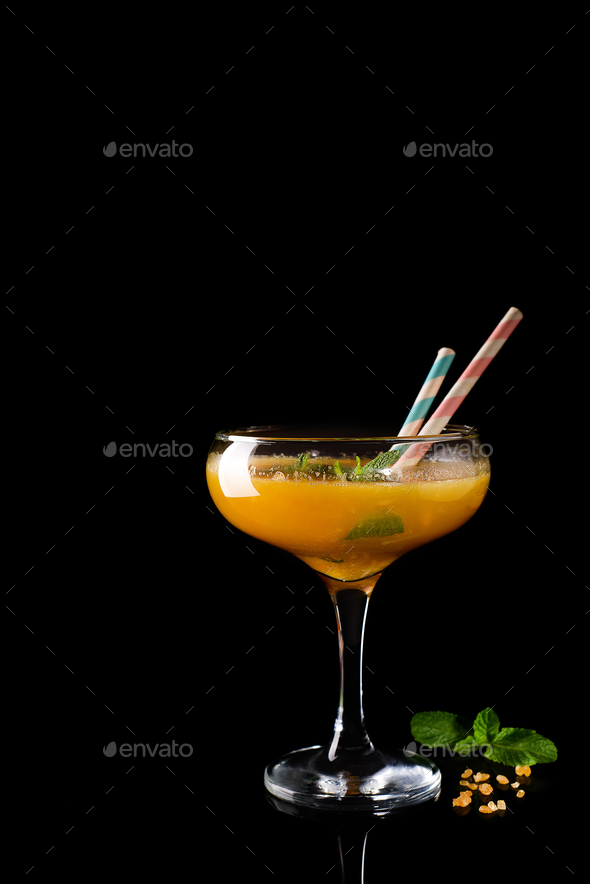 Frozen cocktail smoothie Margarita on a dark wooden background - Stock Photo - Images