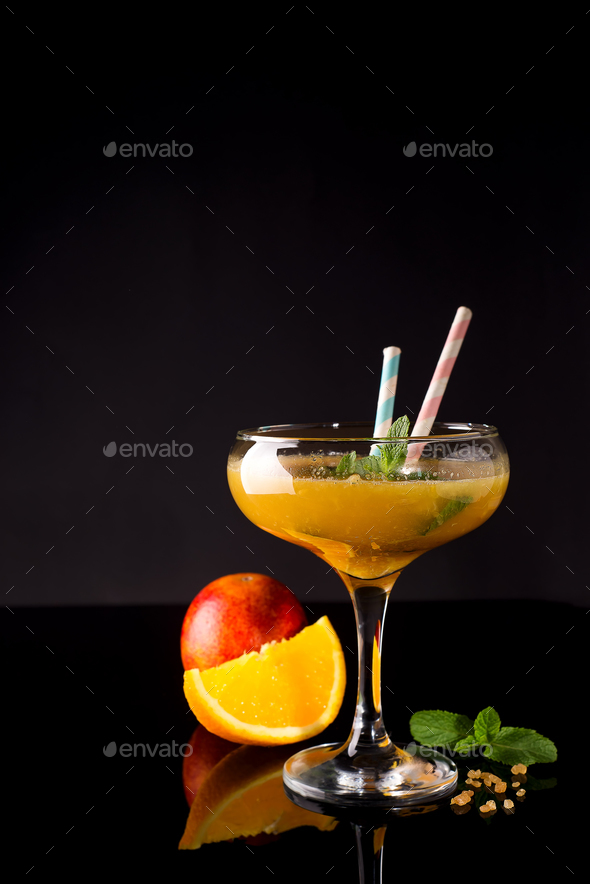 Frozen cocktail smoothie Margarita on a black glass background, - Stock Photo - Images