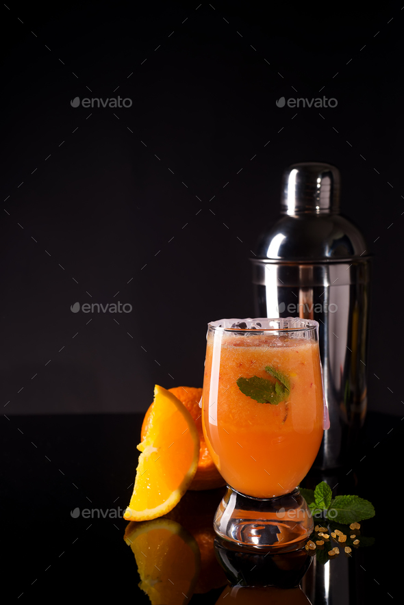 Cocktail Negroni with orange and whiskey on glass black backgorund - Stock Photo - Images