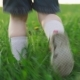 Child Runs on Green Grass in Summer Day - VideoHive Item for Sale
