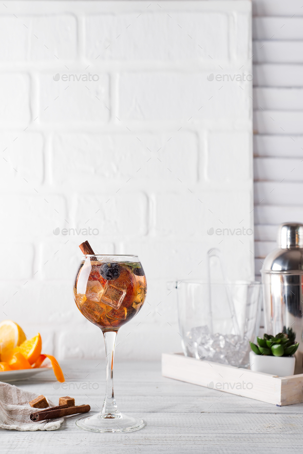 Cold cocktail with cinnamon, berries and brown sugar and tonic - Stock Photo - Images