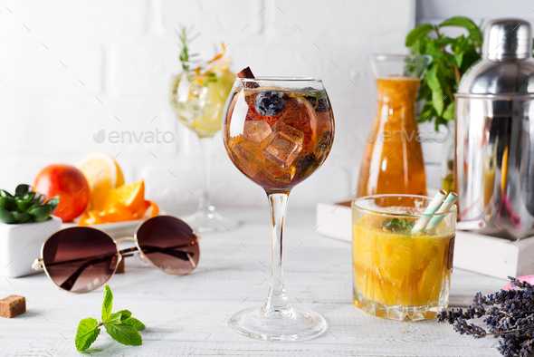 A glass of cocktail and a glass with an orange cocktail or fresh and tonic - Stock Photo - Images