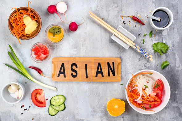 Asian rice noodles with vegetables and vegetarian salad on a plate on stone background - Stock Photo - Images