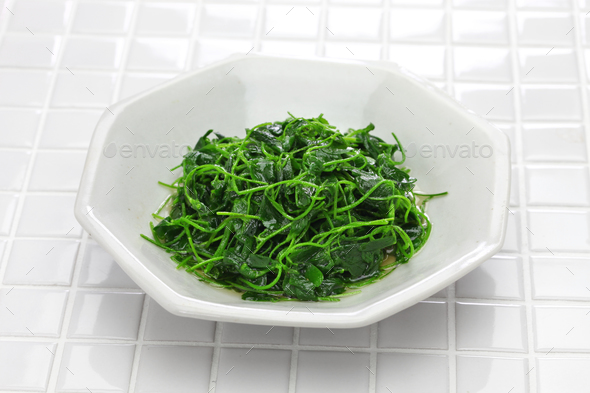 chinese white wine stir fried with toothed bur clover, shanghai cuisine - Stock Photo - Images