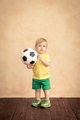 Child is pretending to be a soccer player - PhotoDune Item for Sale