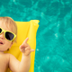 Funny baby boy in swimming pool - PhotoDune Item for Sale